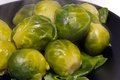 Boiled brussel sprouts on the black plater Stock Photography