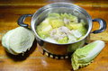 Boiled chinese cabbage with egg tofu and minced pork soup in hot pot the Stock Images