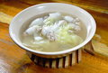 Boiled chop pork stuffed squid with chinese cabbage hot soup in bowl the Royalty Free Stock Images