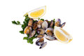 Boiled clams with lemon slices on white background Stock Photo