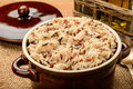 Boiled color mixed rice in ceramic bowl on brown wooden table Royalty Free Stock Images