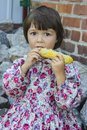 Boiled corn little girl eat Stock Photos