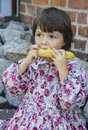 Boiled corn little girl eat Royalty Free Stock Photos