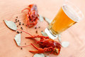 Boiled crawfish with beer on the table Stock Images