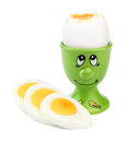 Boiled egg in an egg cup cooked a green with a painted face and slices of hard isolated on white background Royalty Free Stock Images