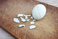 Boiled egg and egg-shell on a board Royalty Free Stock Photos