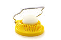 Boiled egg in the egg slicer. Royalty Free Stock Photos