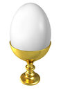 Boiled egg in golden cup. Royalty Free Stock Photo