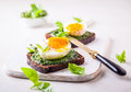 Boiled egg with pesto on toast Royalty Free Stock Photo
