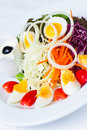 Boiled egg salad on the white plate and white background Stock Photo