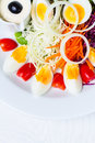 Boiled egg salad on the white plate and white background Stock Photos