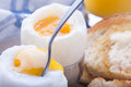 Boiled eggs for breakfast these are duck the very best available organic and raised on grass set with toast and orange juice spoon Royalty Free Stock Photo