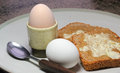 Boiled eggs in egg cup and toast two complete an ready to eat for breakfast Royalty Free Stock Photos