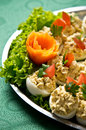 Boiled eggs with fish cream topping plate of elegant buffet style food of halves Stock Photo