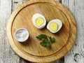 Boiled eggs hard egg on wooden board with salt Royalty Free Stock Images