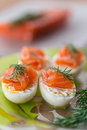 Boiled eggs with salted salmon and herbs Royalty Free Stock Photography