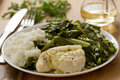 Boiled fish with rice and kale on white plate Royalty Free Stock Photo