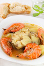 Boiled fish with seafood in plate Royalty Free Stock Image