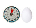 Boiled five minute egg kitchen timer with on a white background Royalty Free Stock Photography