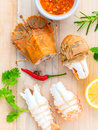 Boiled flathead lobster lobster moreton bay bug oriental flath with herbs and spices sauce on wooden background Stock Image