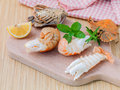 Boiled flathead lobster lobster moreton bay bug oriental flath with herbs and spices sauce on wooden background Royalty Free Stock Photo