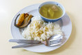 Boiled of gourd with steamed rice fried fish Stock Photo