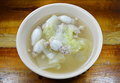 Boiled minced pork stuffed squid with chinese cabbage hot soup in bowl the Royalty Free Stock Photo