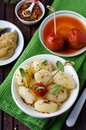 Boiled potatoes with herbs and pickled tomatoes Royalty Free Stock Photo