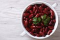 Boiled red kidney beans in a bowl closeup on wooden top view Royalty Free Stock Photo