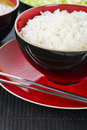 Boiled rice steamed in a black and red bowl and metal chopsticks Royalty Free Stock Photography