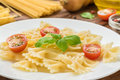 Boiled tasty farfalle on white plate Royalty Free Stock Photo