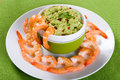 Boiled  tiger prawns tails on plate with guacamole sauce Royalty Free Stock Photo
