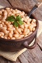 Boiled white kidney beans in a brown pot closeup vertical Royalty Free Stock Photo