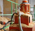 Boiler room hydraulic system supplying wood sawdust Royalty Free Stock Photo