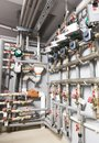 Boiler room vertical shot a lot of pipes Stock Images
