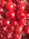 Boiling cherry jam photo with Royalty Free Stock Photo