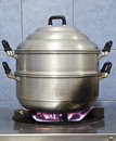 Boiling steaming cooking the pot on the stove Royalty Free Stock Photo
