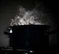 Boiling water in a pot Royalty Free Stock Photo