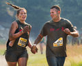 Boise idaho usa august couple and hold hands while running at the the dirty dash in boise idaho on august Royalty Free Stock Images