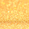 Bokeh christmas gold blinking background golden Stock Images