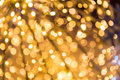 Bokeh defocused gold christmas background abstract Royalty Free Stock Photos