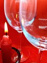 Bokeh Effect, Glass / Crystal Glasses And A Candlestick With A Red Candle On A Red Abstract Background