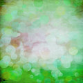 Bokeh on green grunge paper Stock Photos