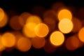 Bokeh orange circles on black background for Halloween. Royalty Free Stock Photo