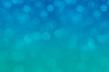 Bokeh soft pastel aqua and blue background with blurred rainbow lights. Royalty Free Stock Photo