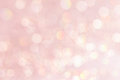 Bokeh soft pastel pink background with blurred golden lights. Royalty Free Stock Photo