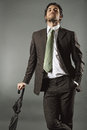 Bold handsome model with elegant suit and umbrella fashion business Stock Photo