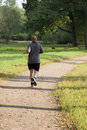 Bold man jogging in the park Stock Photography