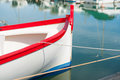 Bold red, white blue closeup of aft of Mediterranean fishermans boat Royalty Free Stock Photo