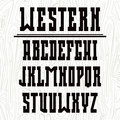 Bold serif font in the western style and wood texture black on light background Royalty Free Stock Photography
